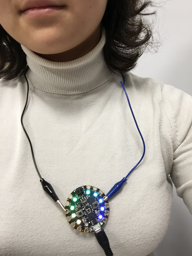 A woman wearing a circuit necklace with lights